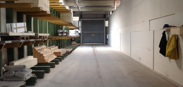 An exit tunnel from the factory with a big garage door at the end.